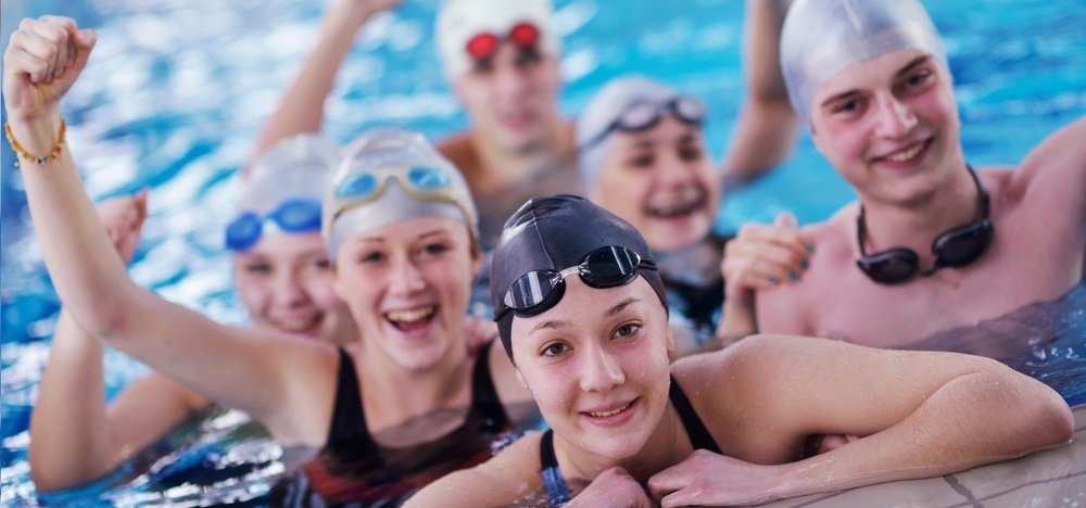 happy teen  group  at swimming pool class  learning to swim and have fun-1