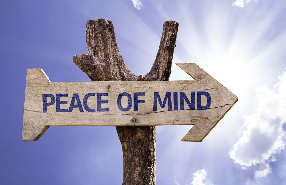 Peace of Mind wooden sign on a beautiful day