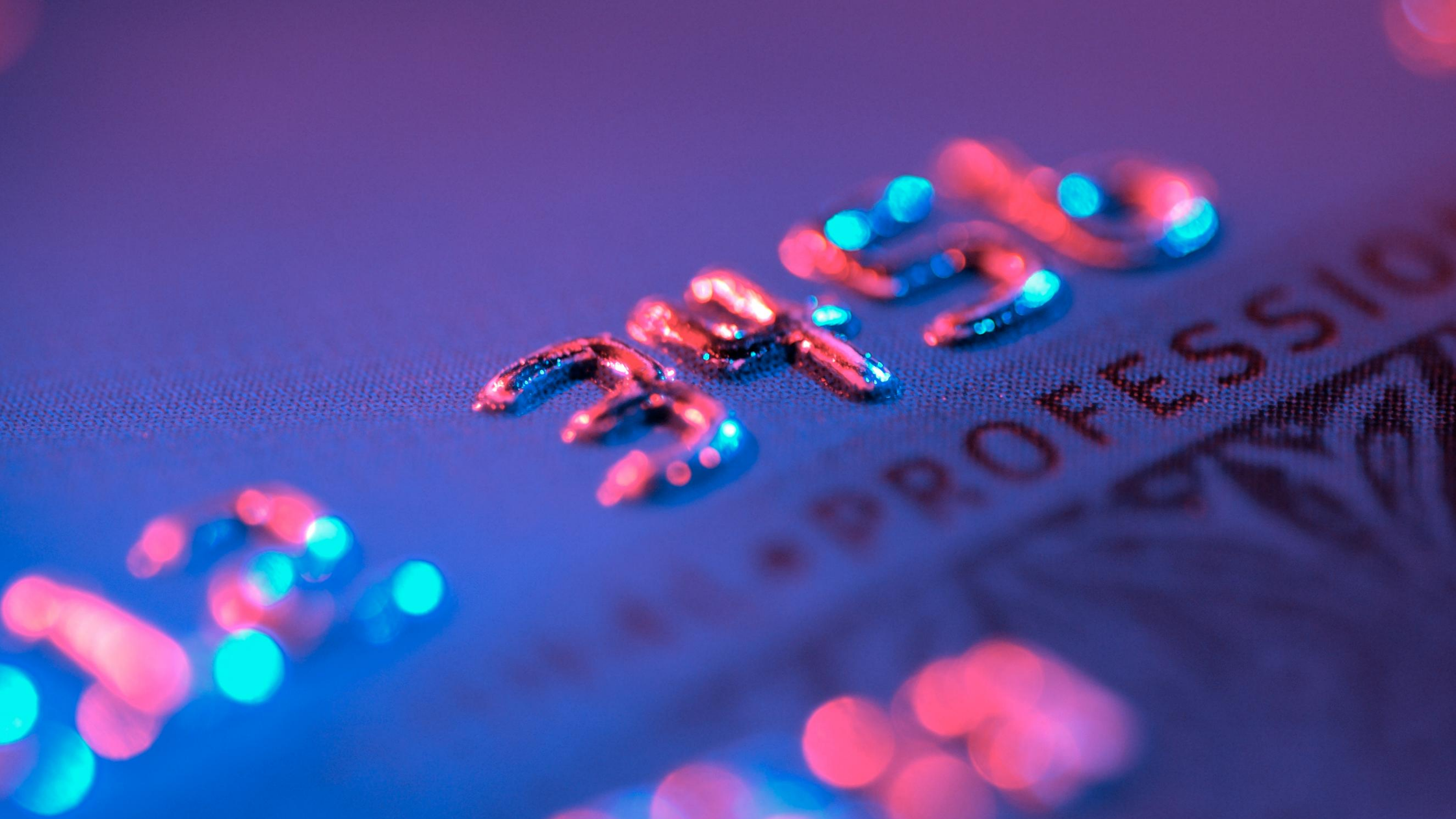 Close up of a credit card pink and purple